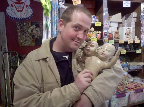 Picture of a two-headed baby doll from the American Visionary Art Museum gift shop