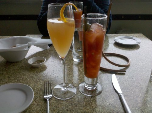 Picture of a mimosa drink and a bloody mary drink.