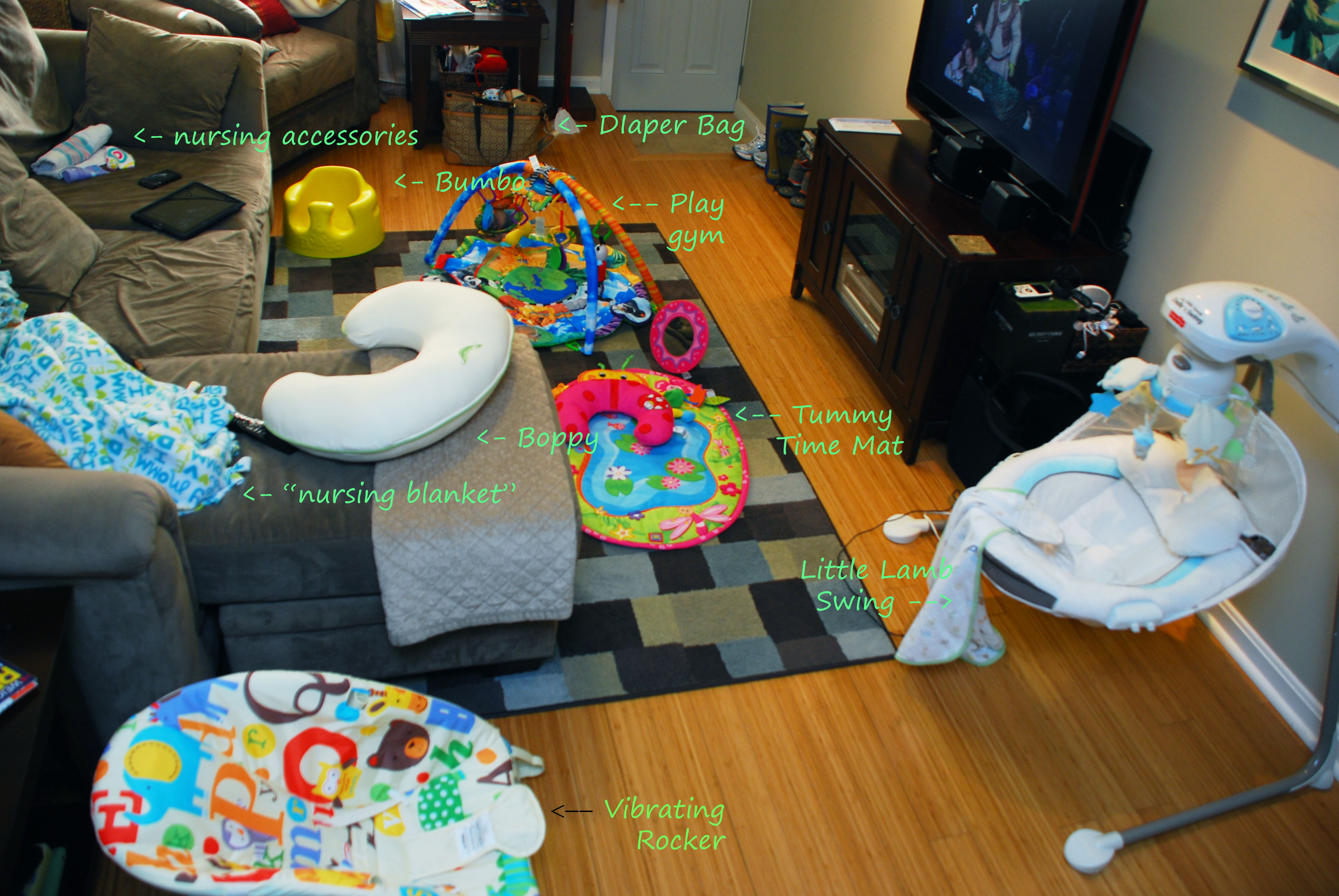 A Photo Of My Living Room Filled With Baby Junk