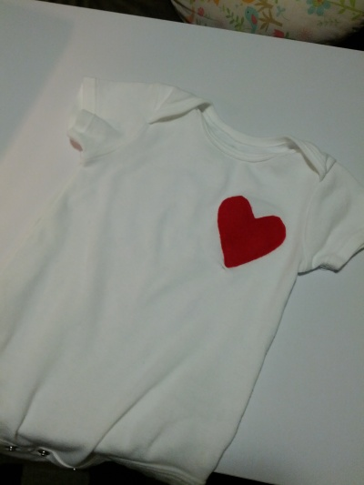 Onesie with a heart sewn on it